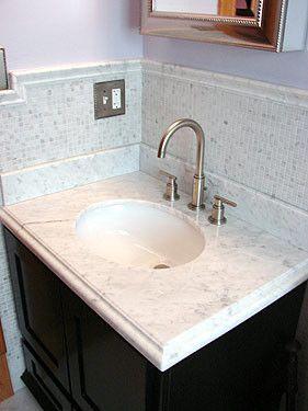 A Marble Bathroom Vanity And Matching Backsplash Washbasin Design