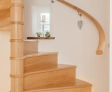 Love these solid wood spiral stairs.