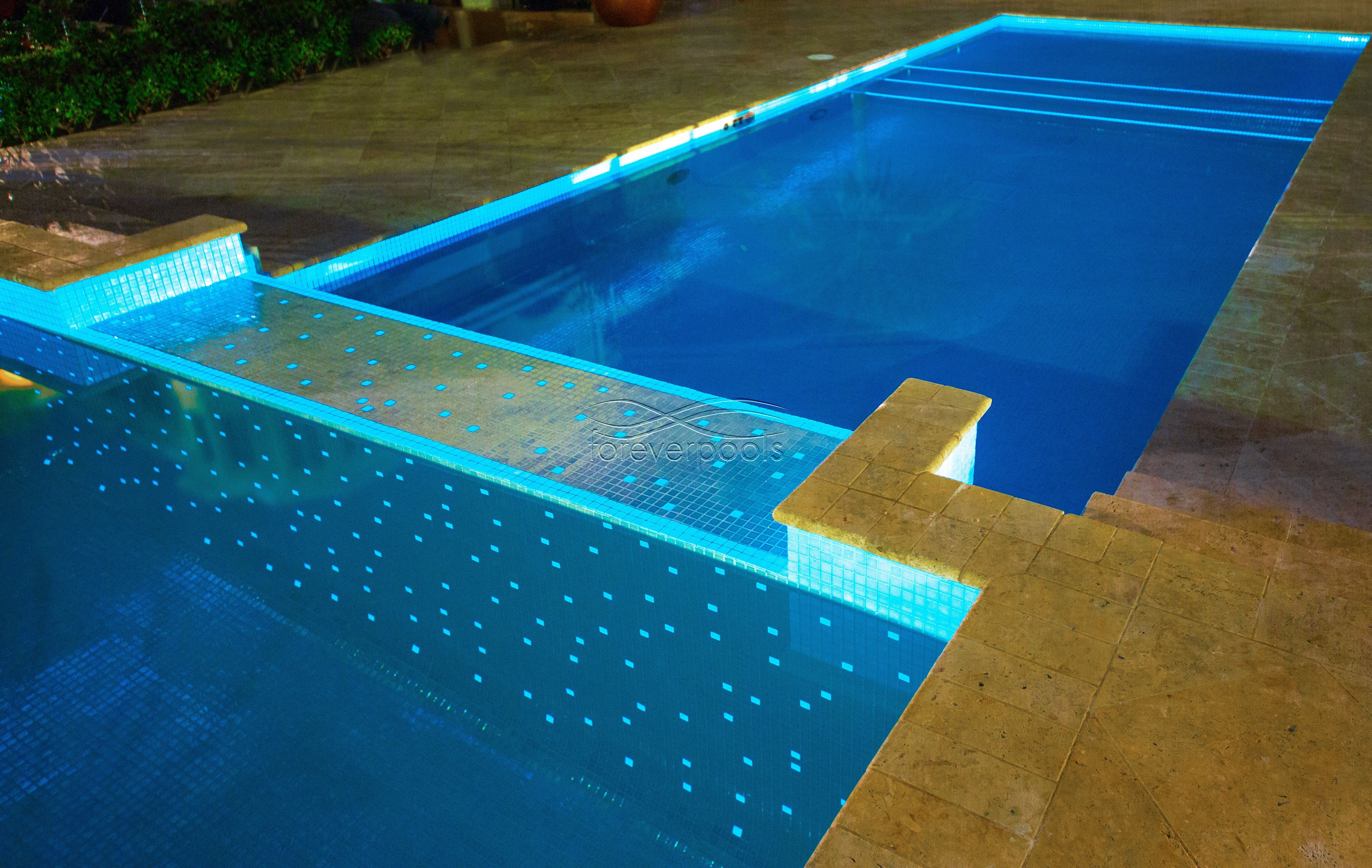 Glow In The Dark Swimming Pool Tiles Glowing Pool Swimming Pool Tiles Pool Tile Swimming Pools