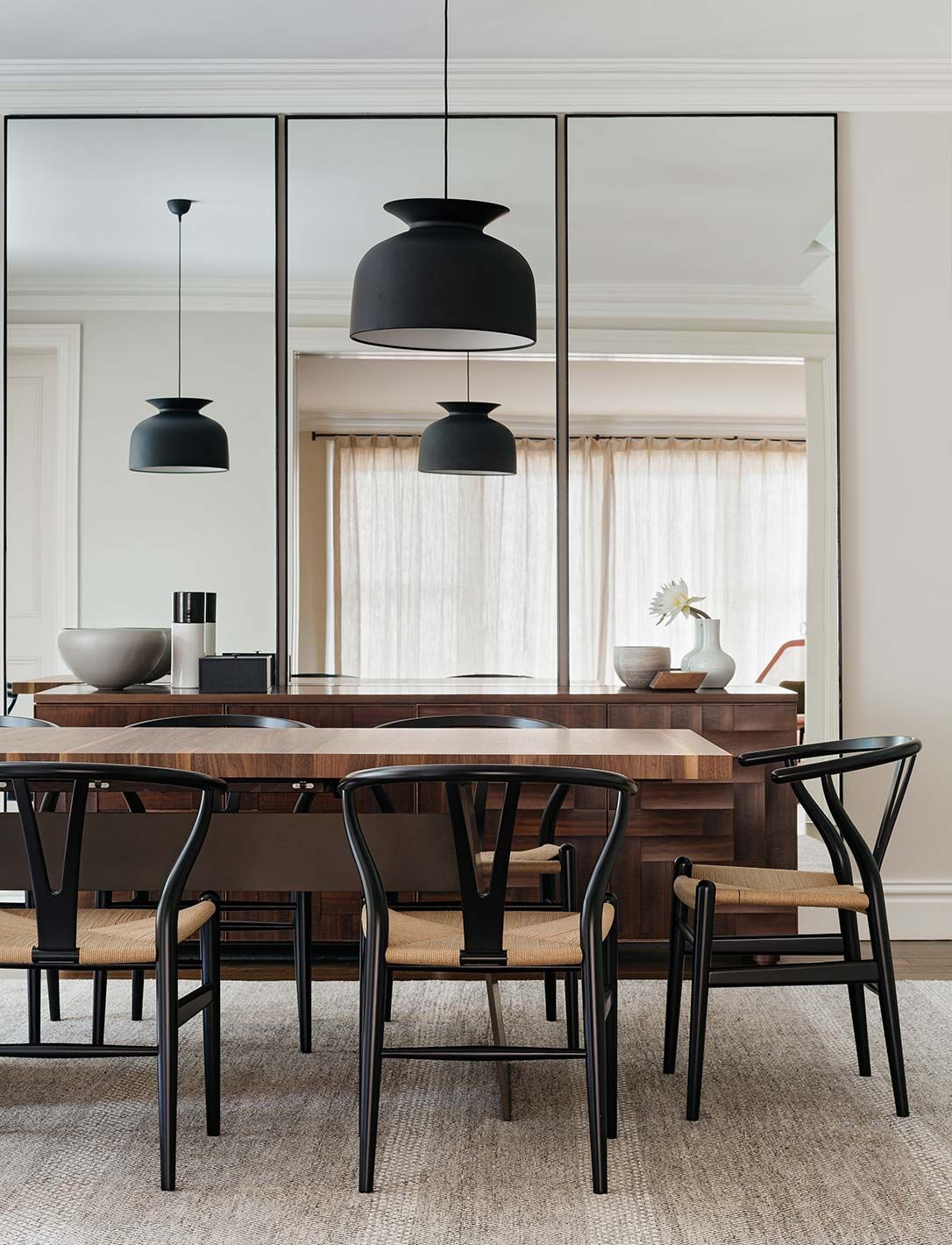 dining room with black wishbone chairs and