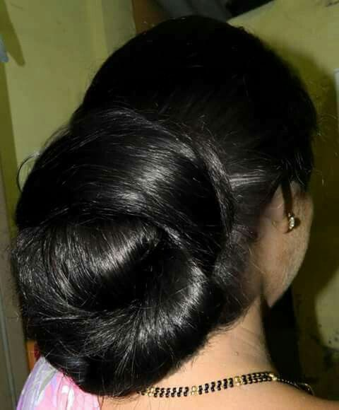 What A Beautiful Large Low Bun Care However Should Be Taken Before Adopting Such Hairst Braided Ponytail Hairstyles Bun Hairstyles For Long Hair Big Bun Hair