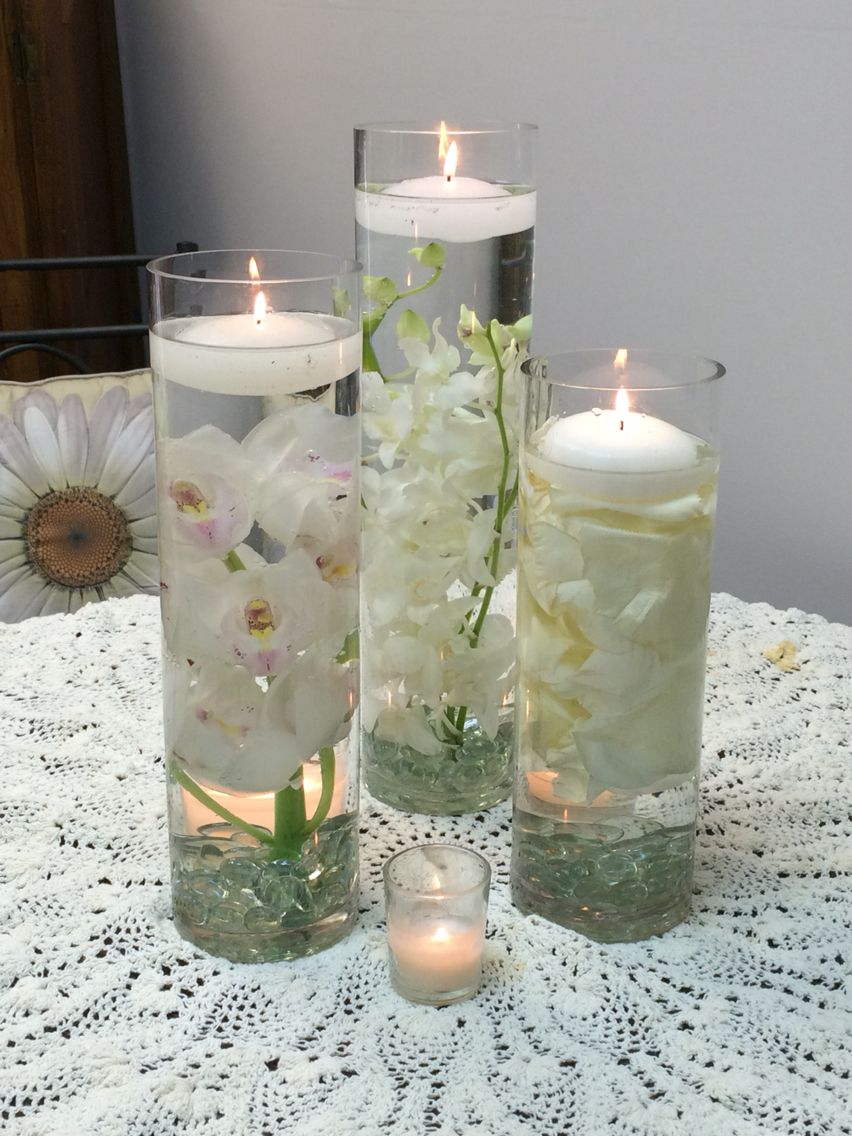 A trio of cylinder vases using white dendrobium orchids white a trio of cylinder vases using white dendrobium orchids white cymbidium orchid and white rose petals reviewsmspy