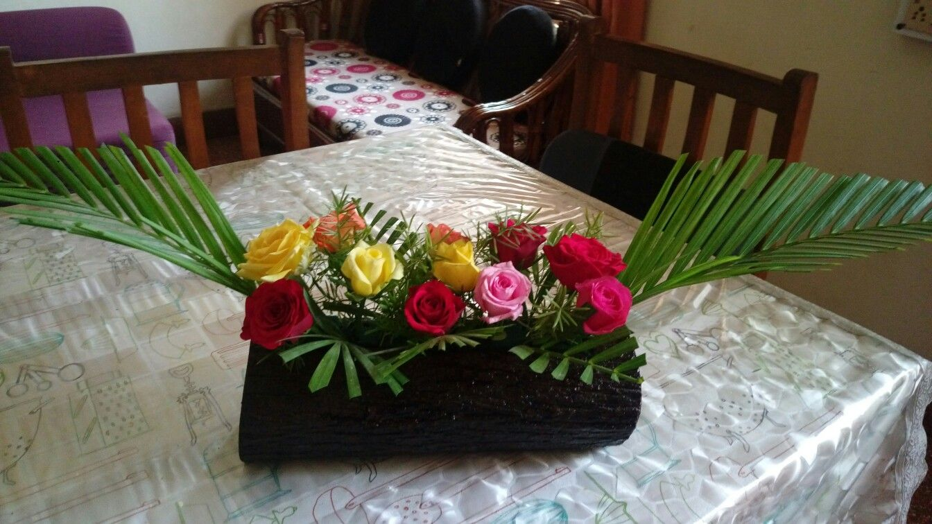 Centre Table Flower Arrangement In A Log