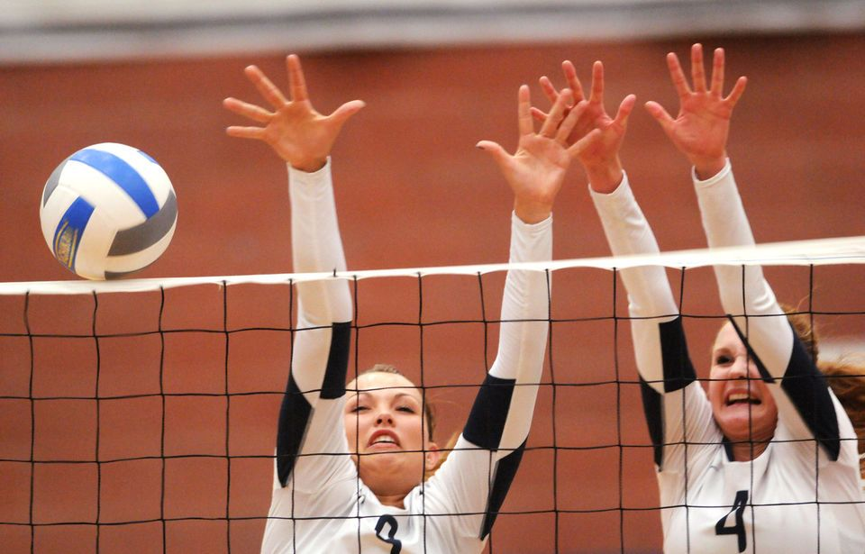 Skyview S Annie Anderson Left And Heidi Wakefield Right Go Up For A Block In The Tuesday Evening Volleyball Match Against Kuna Volleyball High School Kuna