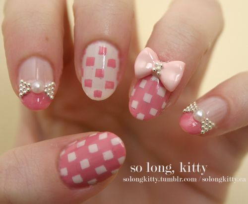 Pastel Checkered Bowtie Nails. Springtime!  Use various shades of pastel pinks to make the checkerboard design. Place a 3D bowtie on your accent nail and add silver micro-beading to accent certain nails.