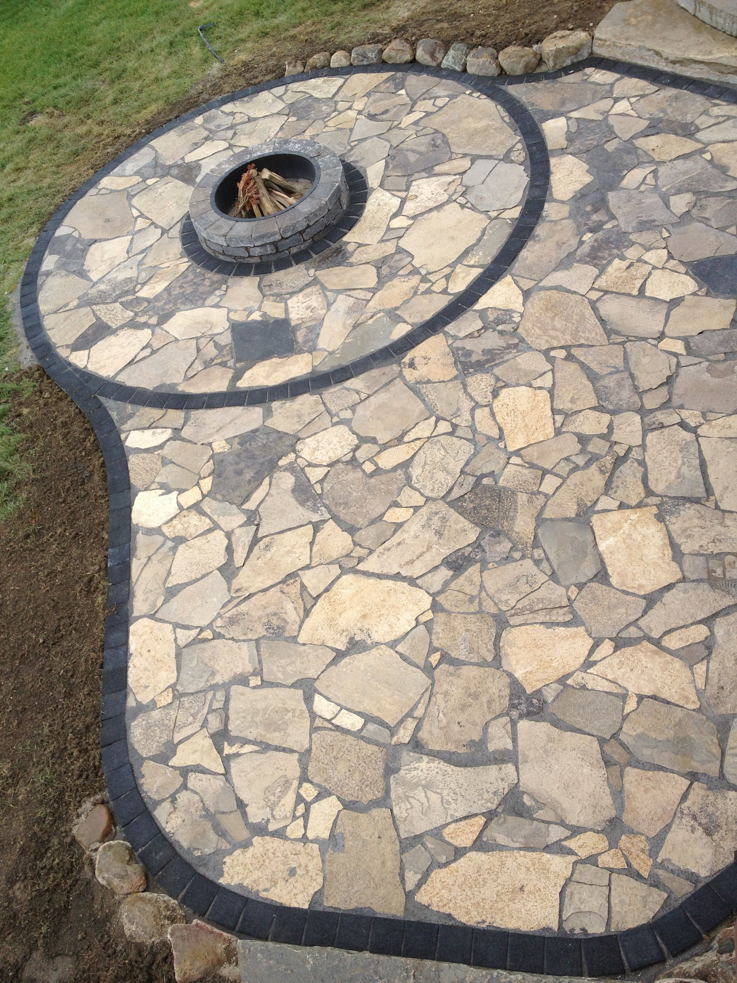 canadian flagstone patio with unilock paver accent bricks by frank spiker of all natural landscapes - Flagstone Patio Designs