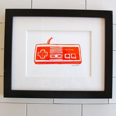 nintendo linocut print by eric rewitzer. i think this might be the mister's birthday present this year.