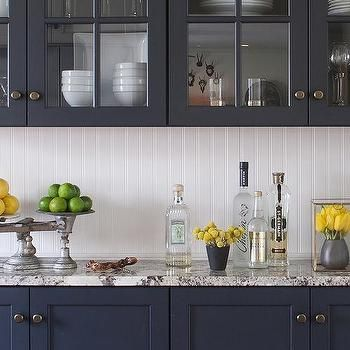 Fantastic, Striking Kitchen Featuring White Shiplap Walls, Navy Blue  Cabinets, And White And