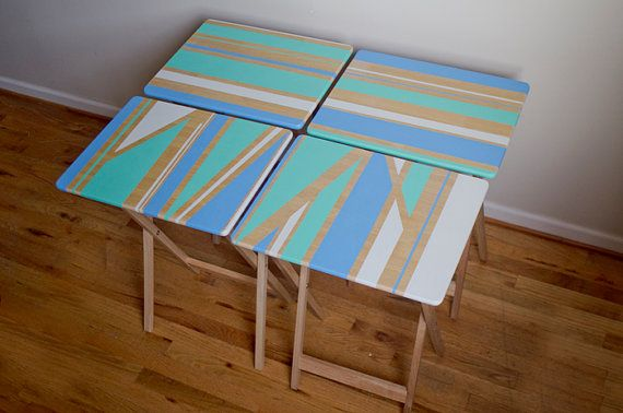 You can buy the same tv tray tables from Walmart super cheap and easily paint your one design