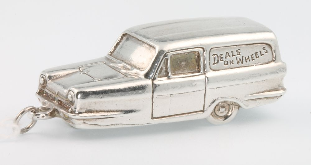 Lot 608, A silver pendant in the form of a Reliant Robin 27 grams est £20-40