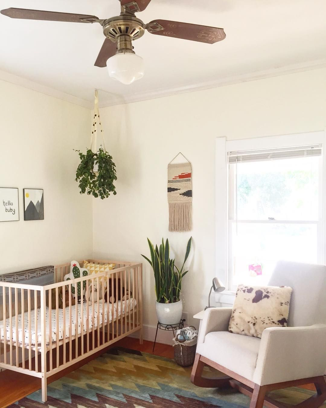 The lighting in this baby boy's nursery is the best 🌞 🍃is
