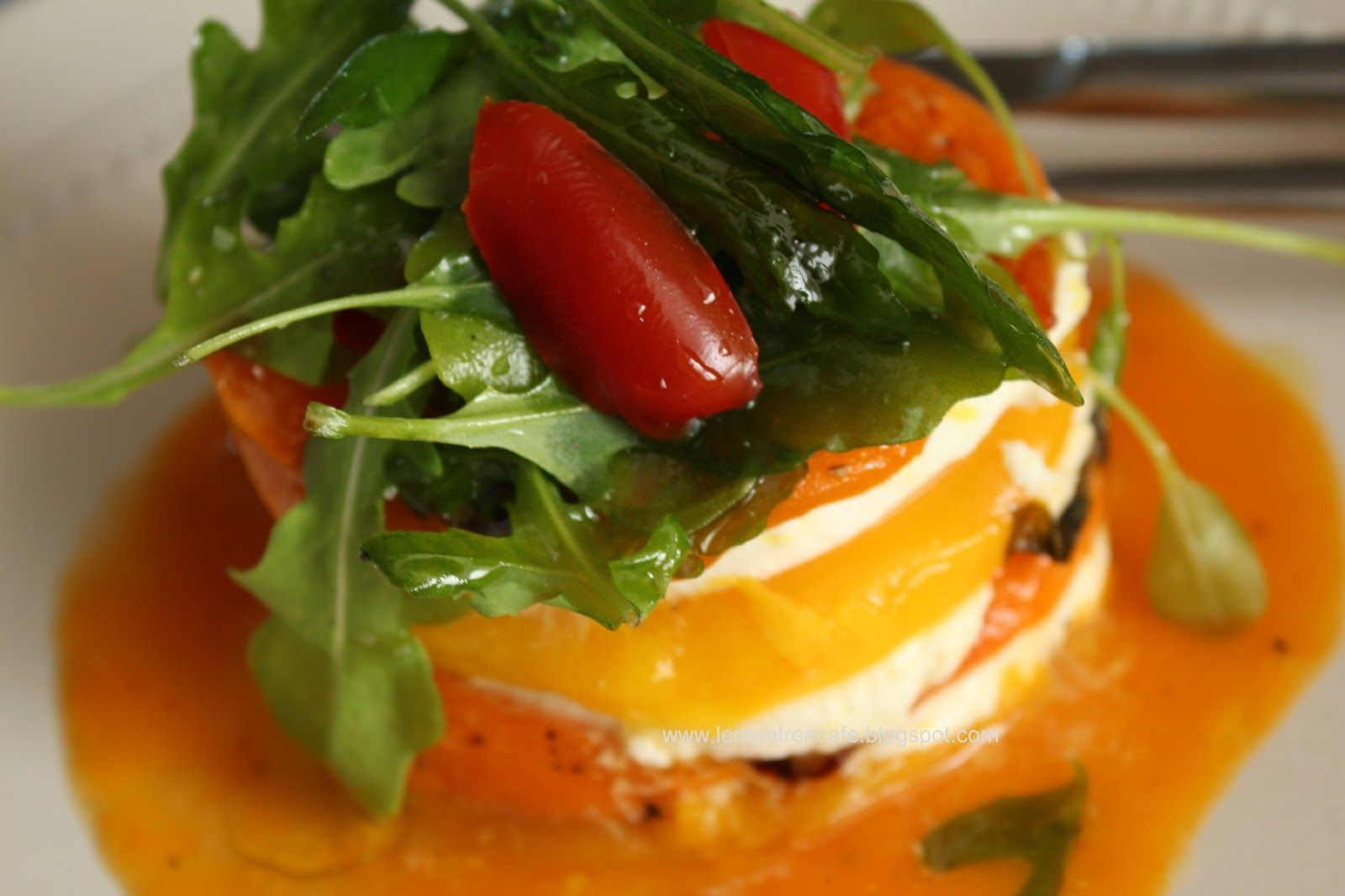 caprese salad of mozzarella, yellow tomatoes and yellow roasted peppers