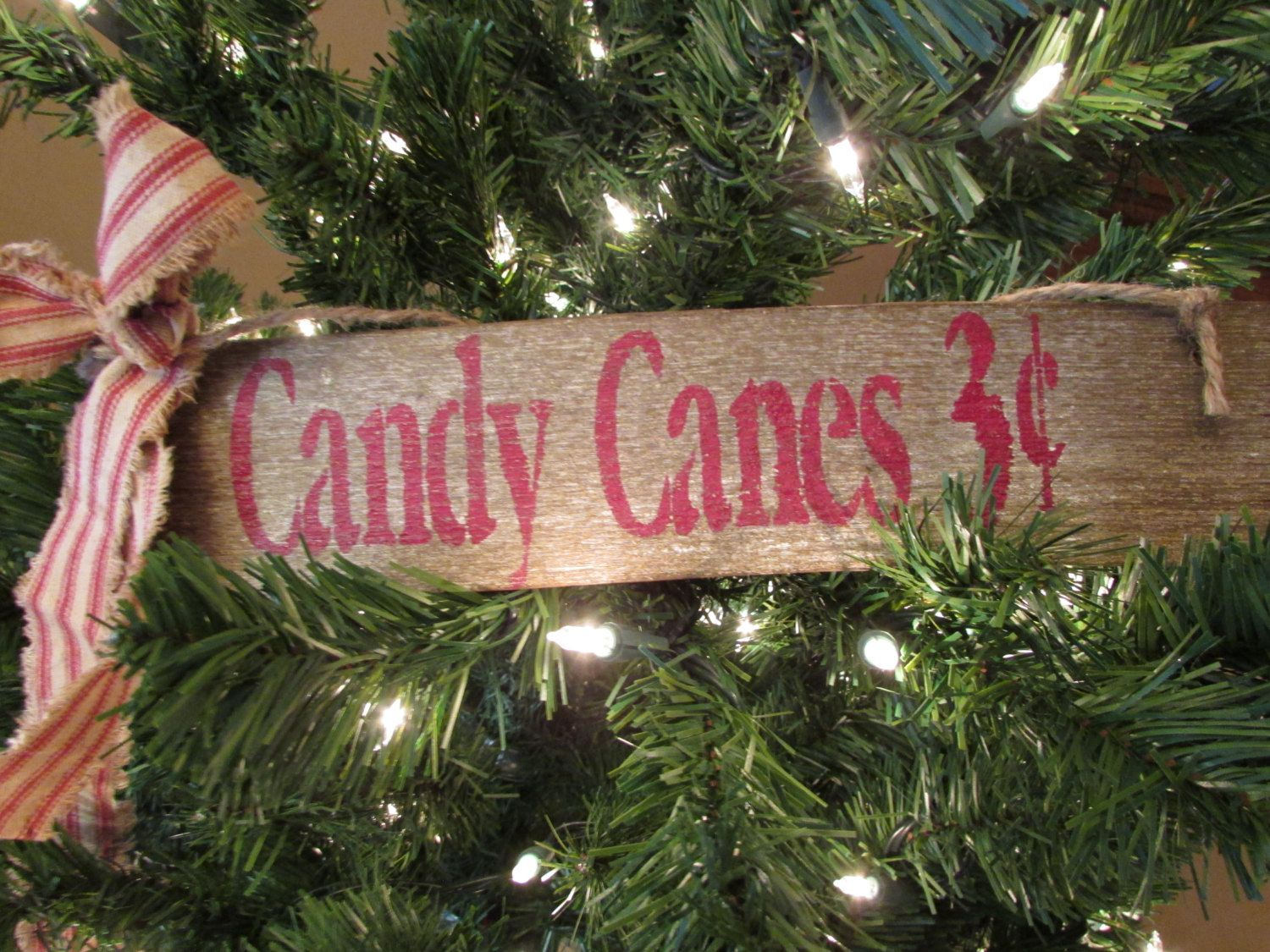 Primitive Candy Cane Sign by Cherriesprimitives on Etsy https://www.etsy.com/listing/211199399/primitive-candy-cane-sign