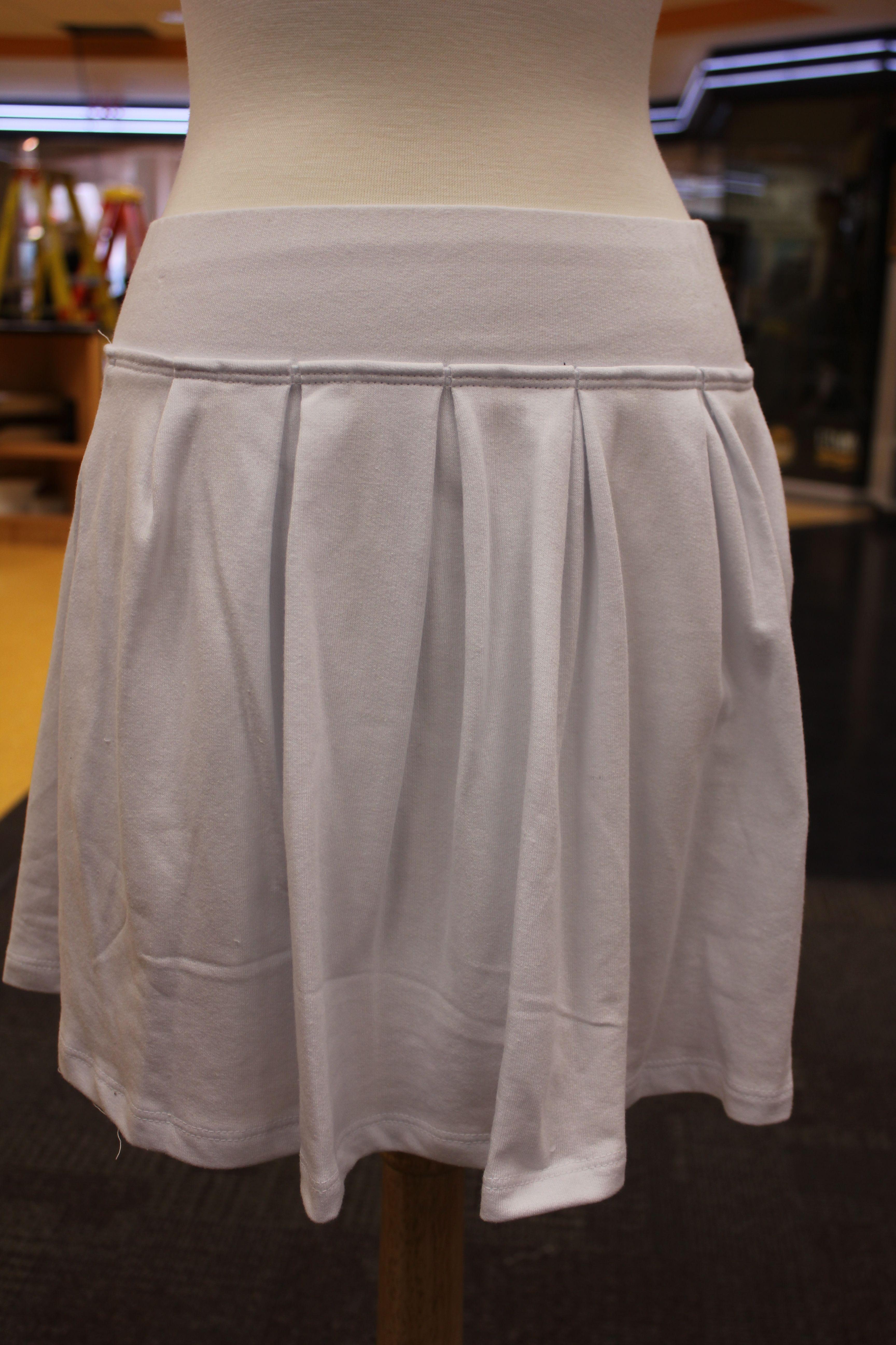 White pleated skirt.