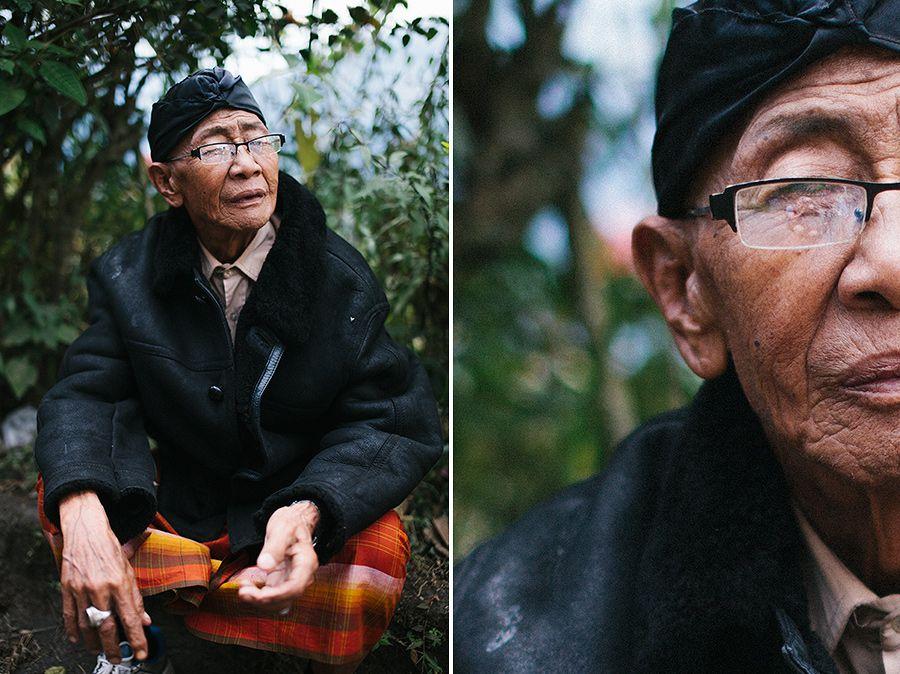 An elderly Balinese man takes a rest while climbing out of Lake Batur (Danau Batur) Kintamani - Bali