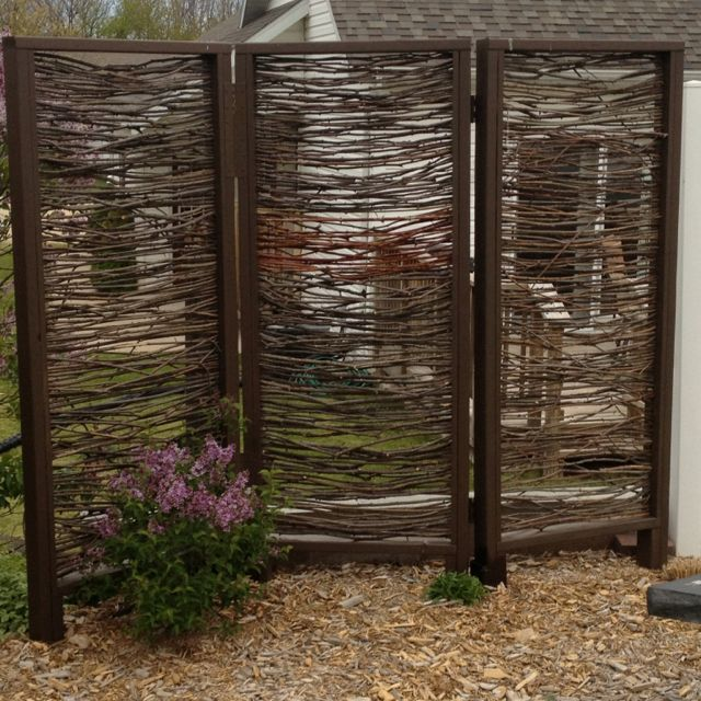 Outdoor privacy screen installed Made with branches by my husband