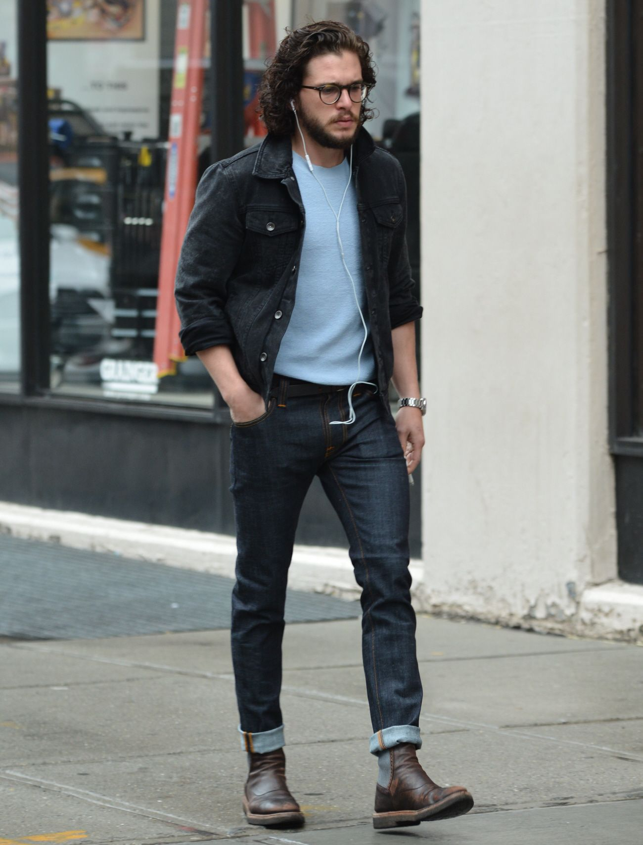 Kit harington wearing black denim jacket light blue crew Black shirt blue jeans