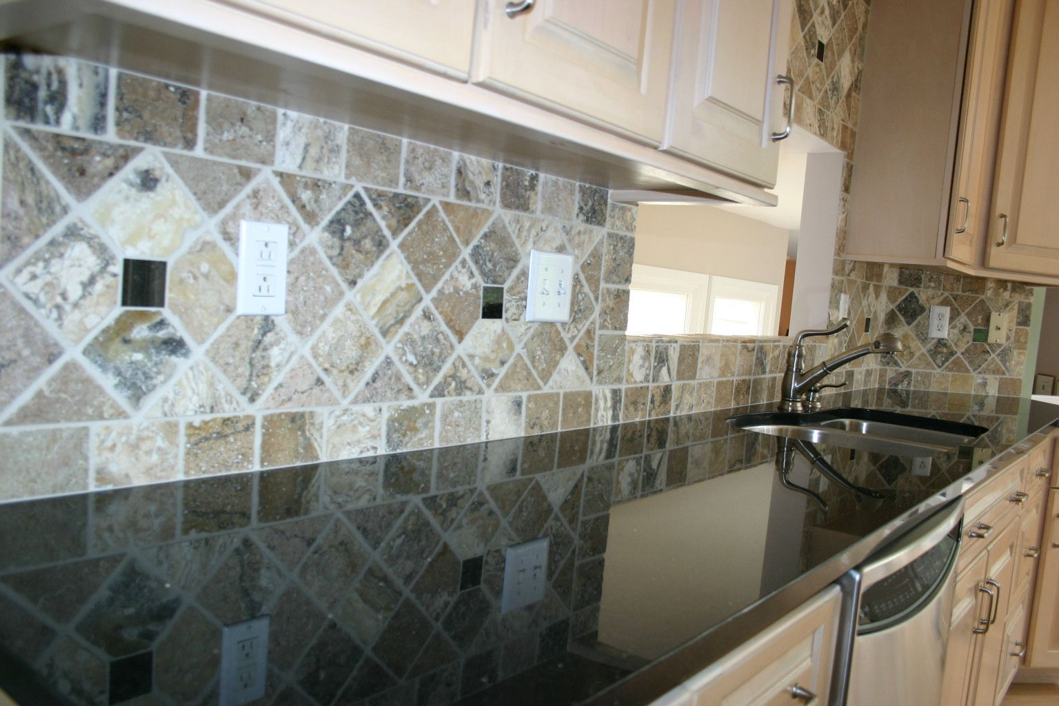 Kitchen Backsplash For Black Granite Countertops engaging-black-galaxy-granite-countertops-white-broken-stained