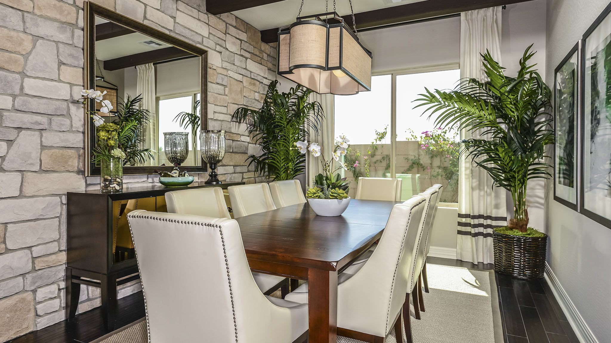 LOVE This Dining Space ~ Love the Stone Wall!