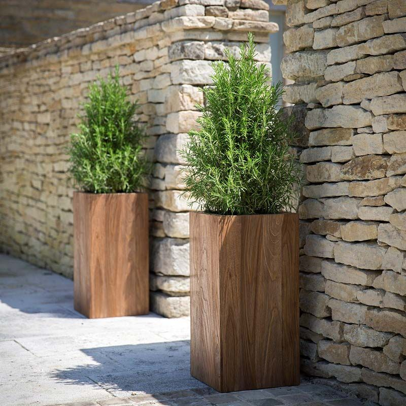 This tall square wooden garden planter is simple and stylish and is ideal for patios or