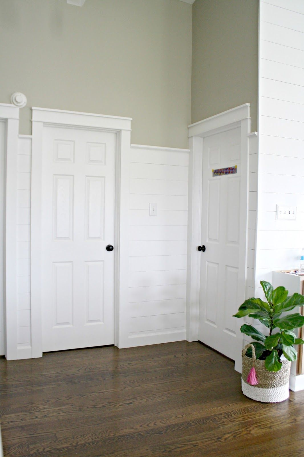 finished shiplap walls and farmhouse door trim in the loft on wall trim id=33996