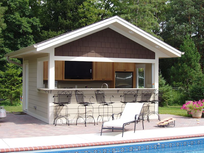 Build a bar into the side of your pool house where family for Small pool house with bathroom