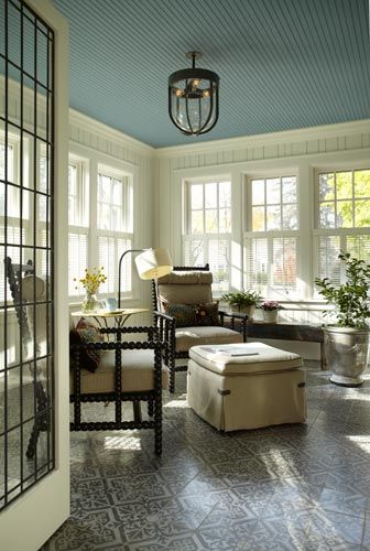 Beautiful Sun Porch With Painted Wood Floors And Blue Slatted