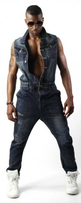 fff70003af37 Blue denim sleeveless jumpsuit steps out of men s boiler room and into the  streets.