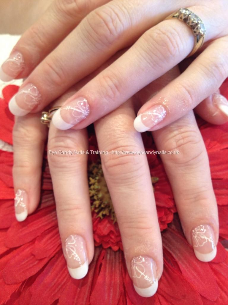 White French Polish With Freehand Nail Art