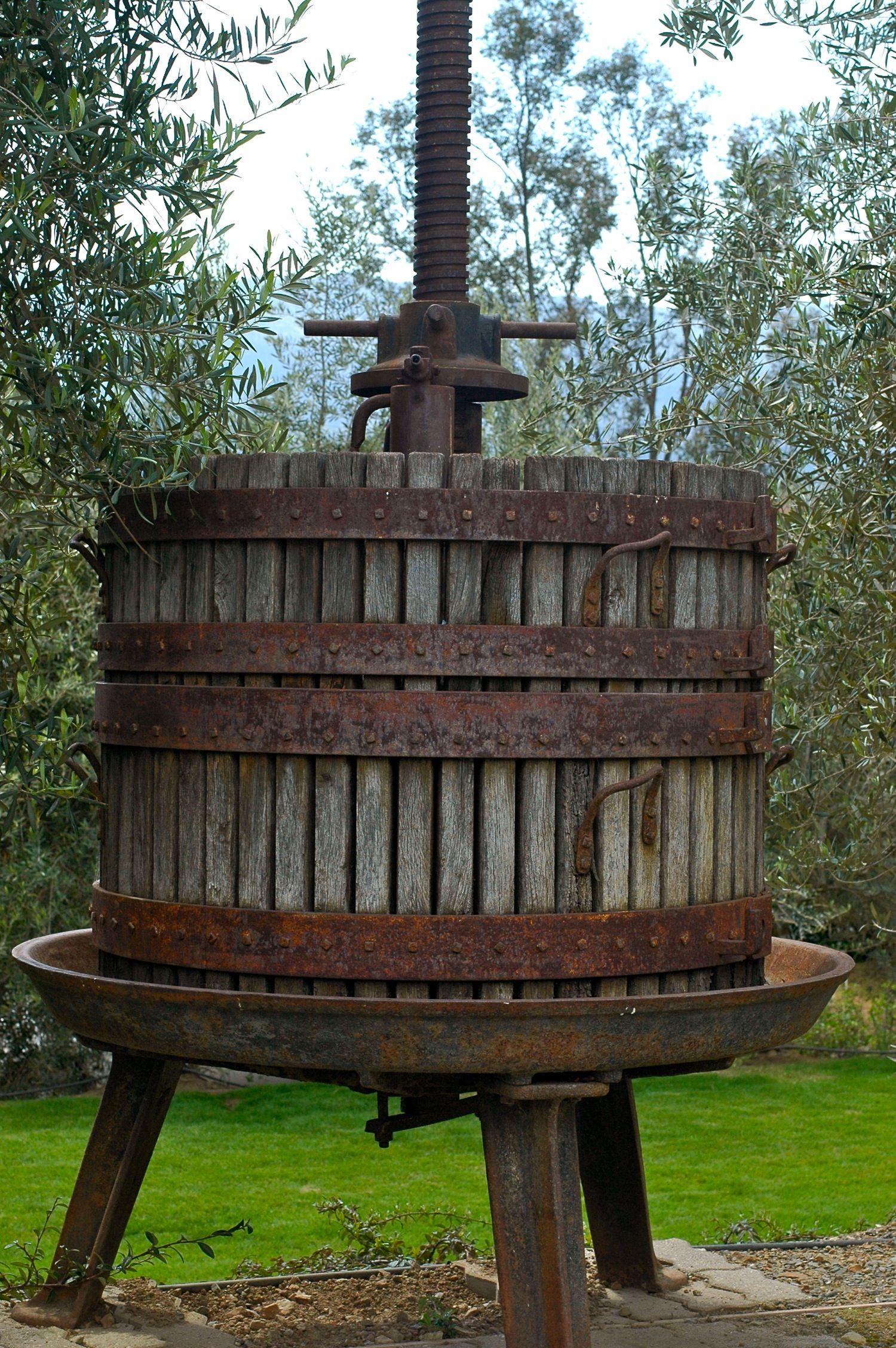 Old school wine press at Pina Napa Valley