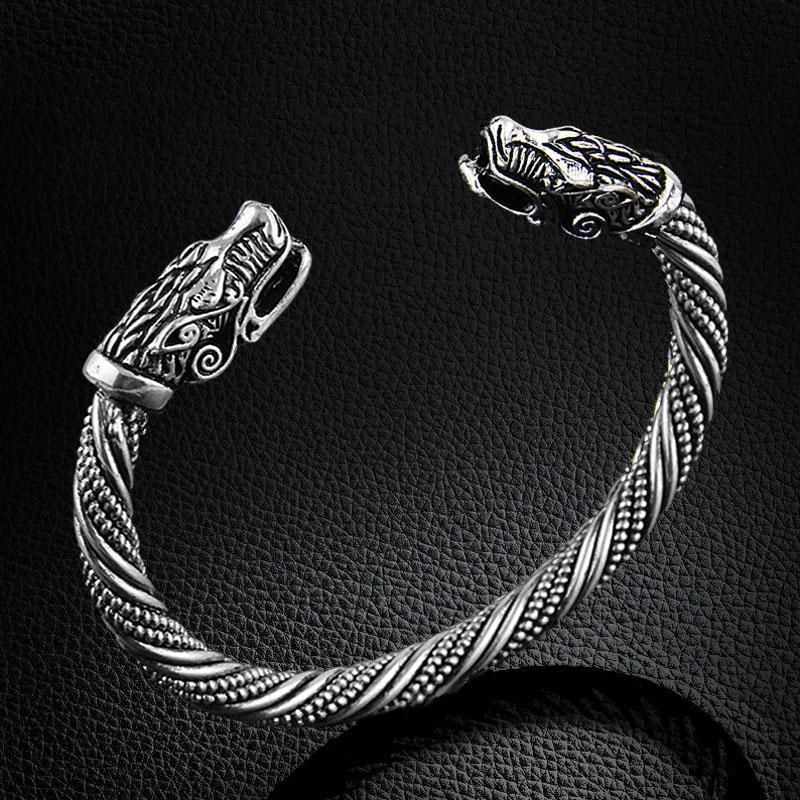 d35d2891791323 Dragon's Head Bracelet. This viking dragon bracelet comes in two colours; silver  and gold, and is fully adjustable to fit any size.