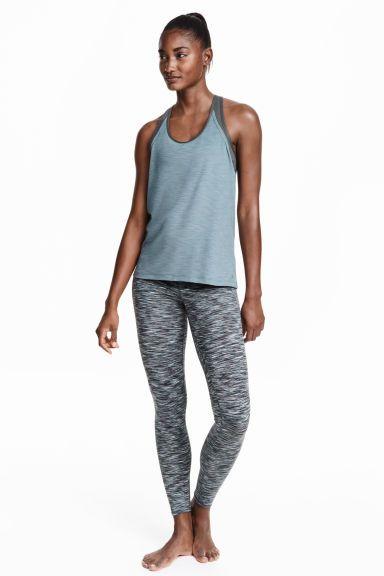 Mallas de yoga: Mallas de yoga en tejido funcional de secado rápido. Cintura elástica ancha cruzada y bolsillo oculto de malla en la pretina para las llaves.