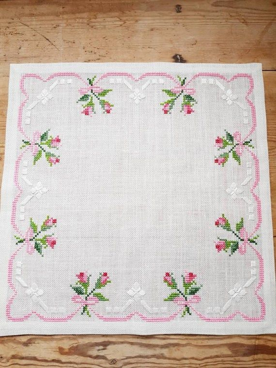 Lovely floral/roses cross stitch embroidered tablecloth in white linen from Sweden