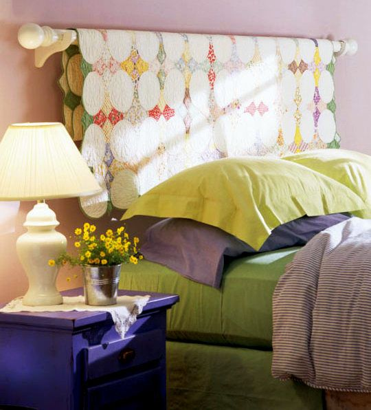 DIY 10 Creative Budget Headboard Ideas...including this one using a quilt behind the bed.