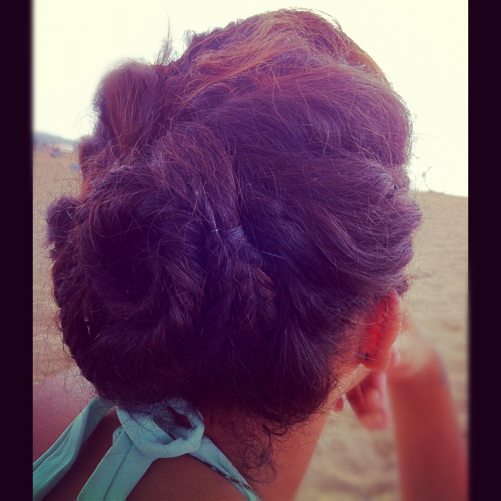 Beach hair style braided sides hump pulled together in three