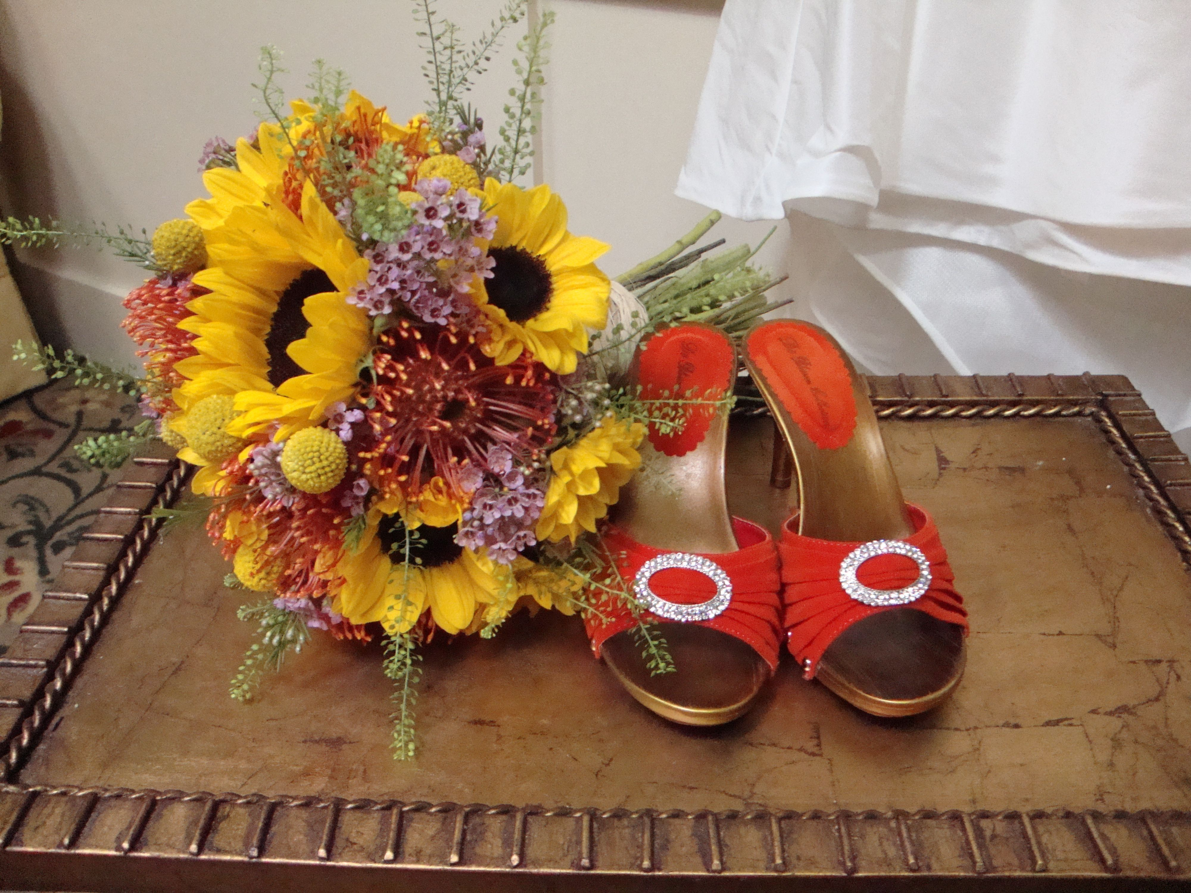 Wedding bouquets of sunflowers  Sunflowers Pin Cushion Protea Craspedia Wax Flower and Pennycress