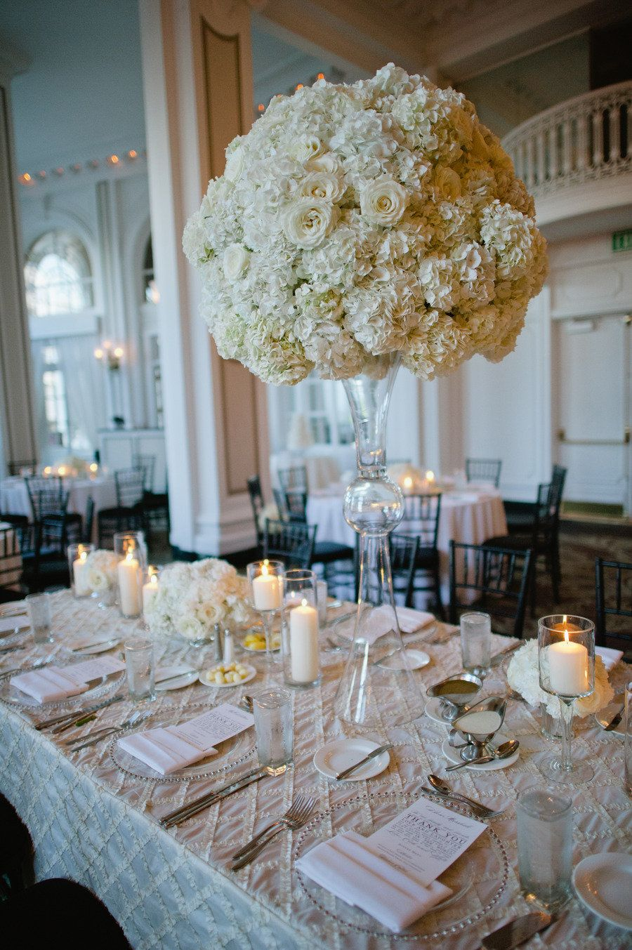 Elegant white wedding - love the big centrepieces. Will probably be expensive though... Silk flowers maybe?