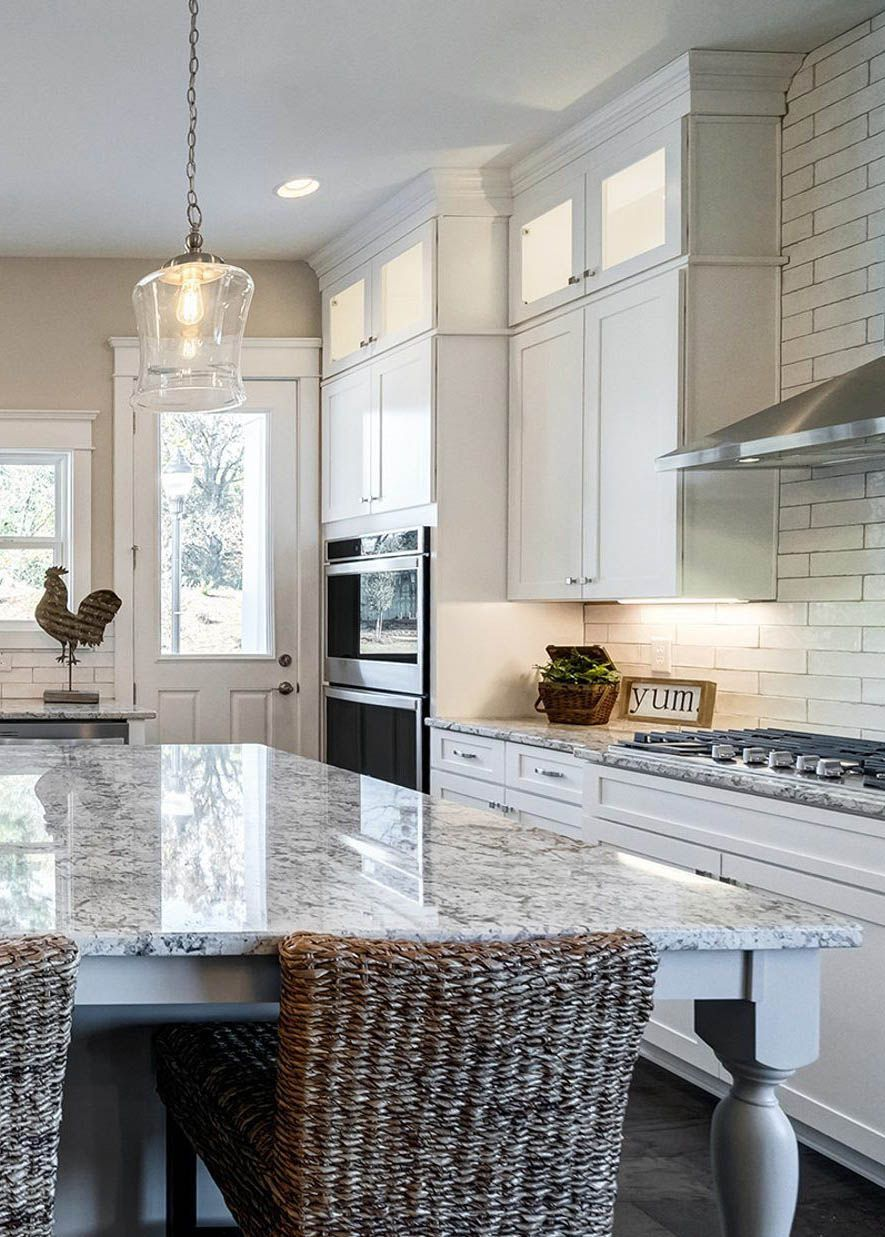 Granite Kitchen Countertops With White Shaker Style Cabinets White Tile Backsplash In 2020 Granite Countertops Kitchen White Tile Backsplash Tile Countertops Kitchen