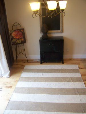 I am loving the painted canvas rugs.  Cheap, cute and functional