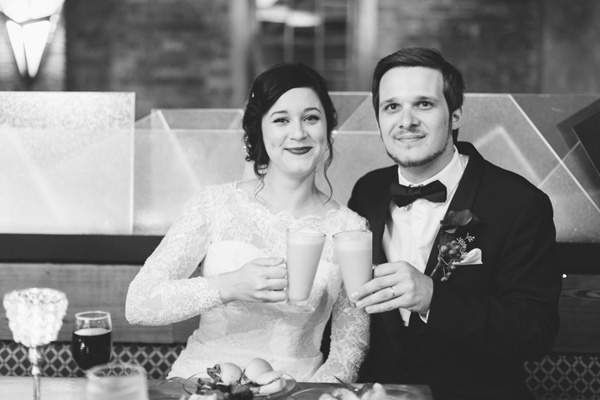 bride and groom toasting their new marriage @myweddingdotcom