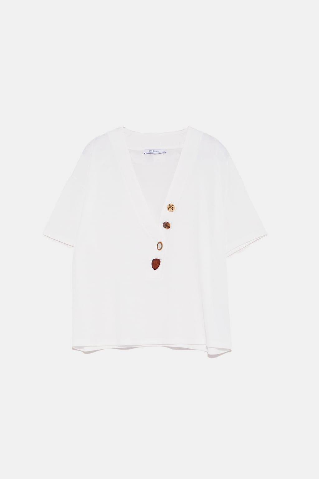 0d969620874 Image 6 of T-SHIRT WITH CONTRASTING BUTTONS from Zara
