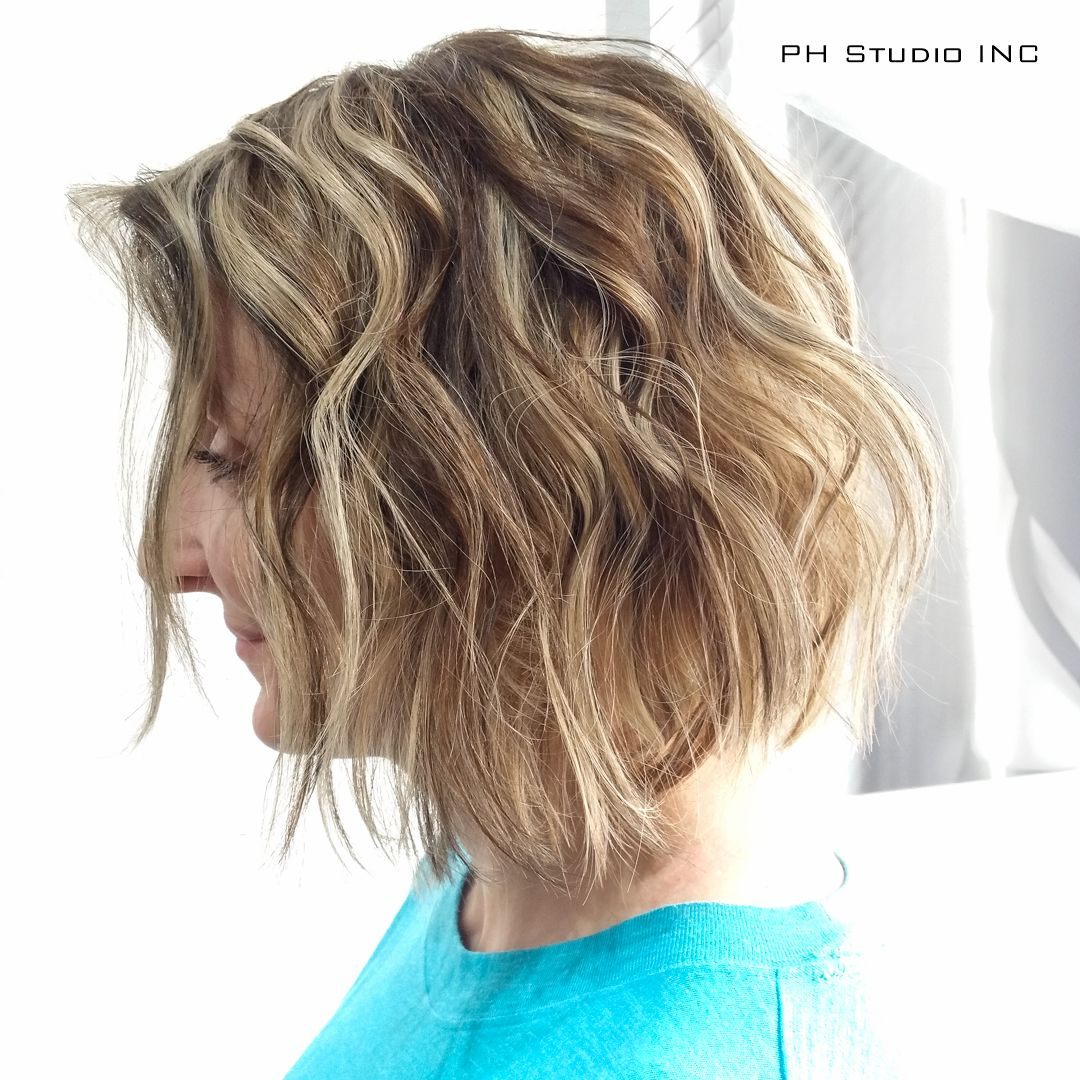 Edgy medium layered bob haircut with blonde highlights and ...