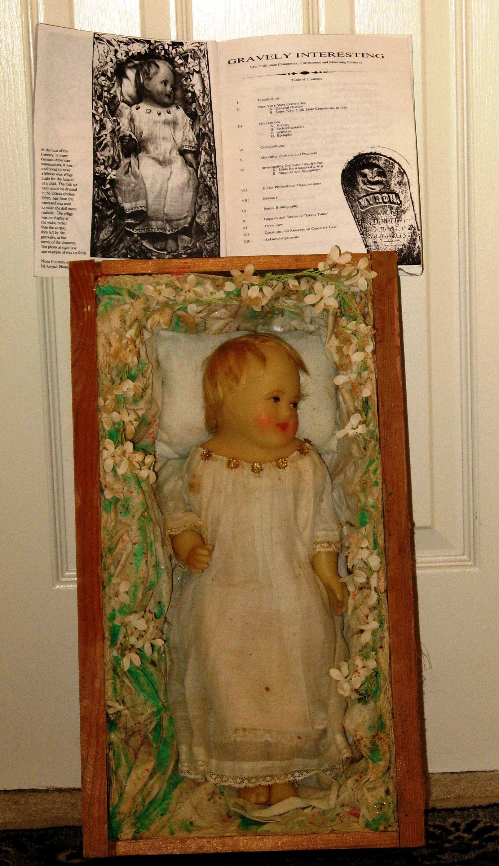 Grave dolls were sometimes made and left at the grave of a deceased infant. It was made of wax, and had locks of hair from the deceased child. It sounds morbid by today's standards, but it was not too uncommon in the 19th century.