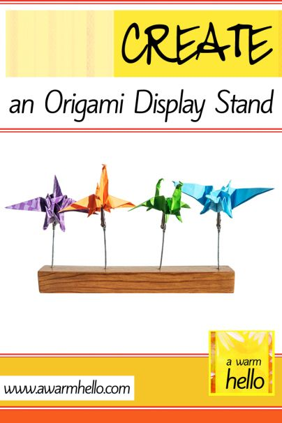 CREATE An Origami Display Stand A Piece Of Wood Coat Stain Few Drill Holes Some Alligator Clips And Glue Youve Got