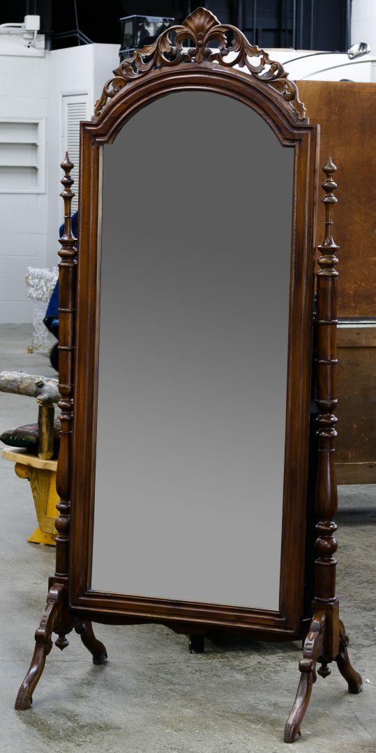 Lot 88: Mahogany Cheval Floor Mirror; Having a hinged mirror on a ...