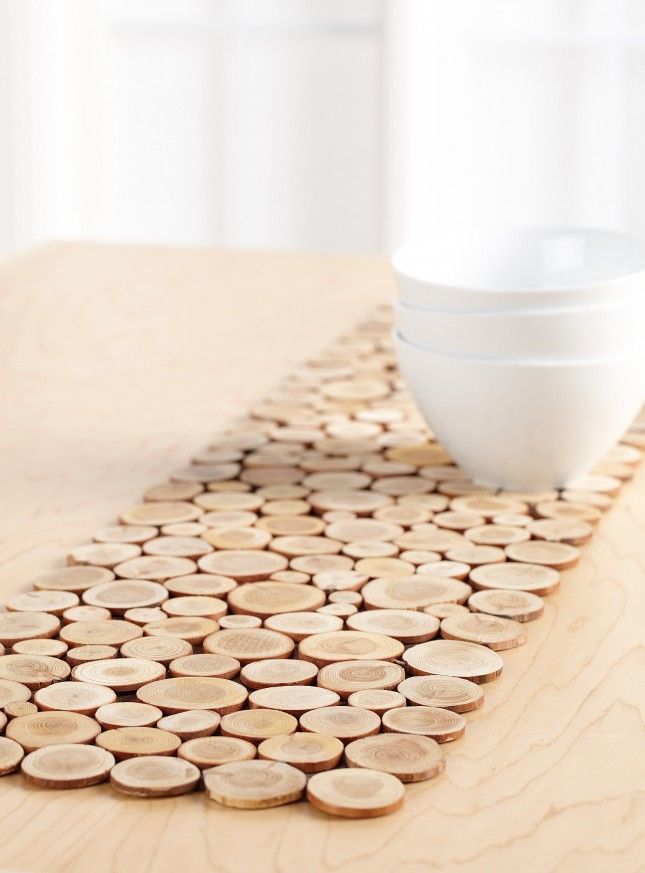 Use mini wood slices and a piece of felt to diy this table for Easy diy table runner