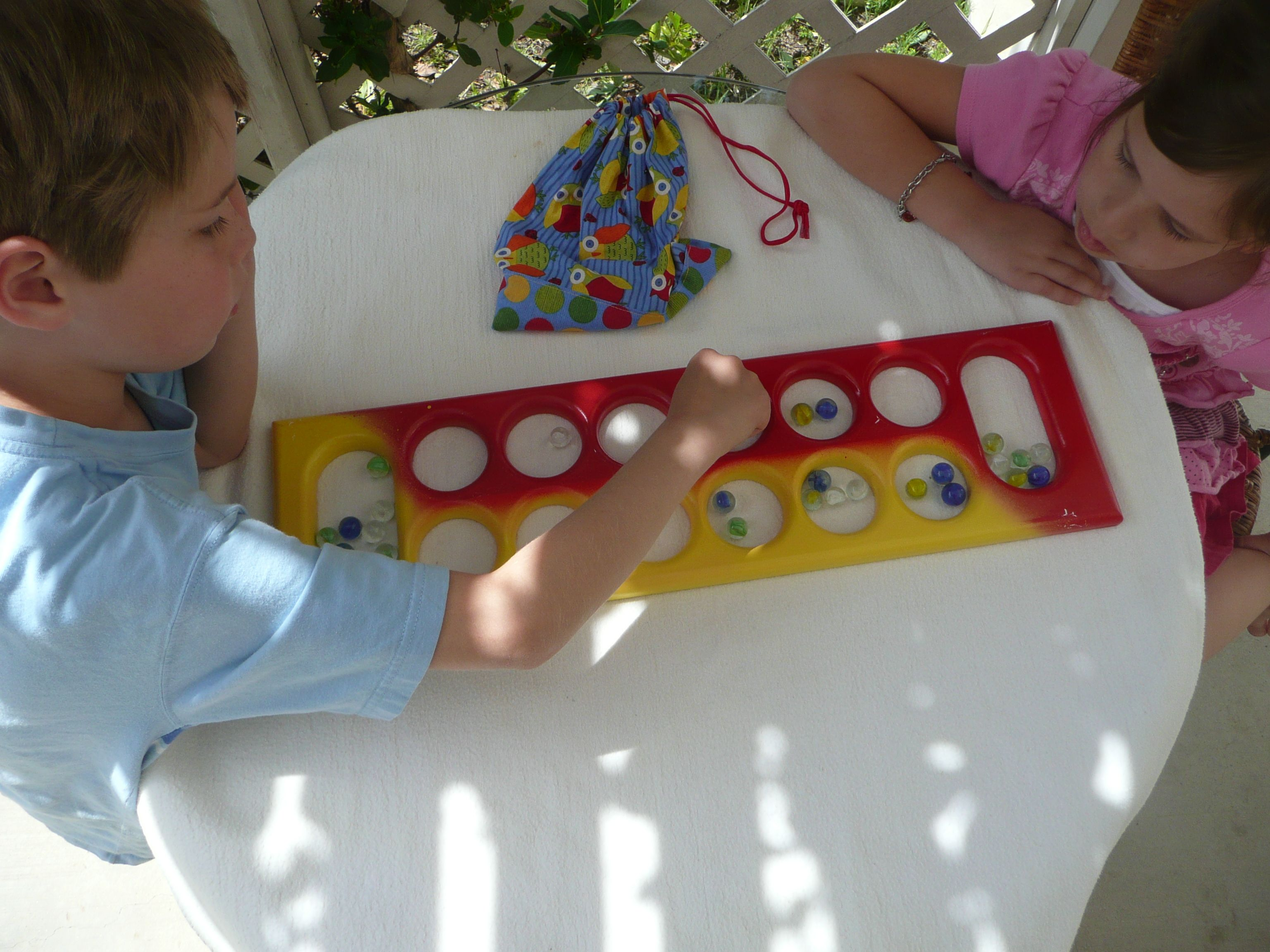 how to play mancala aka the marble game gaming plays and marbles