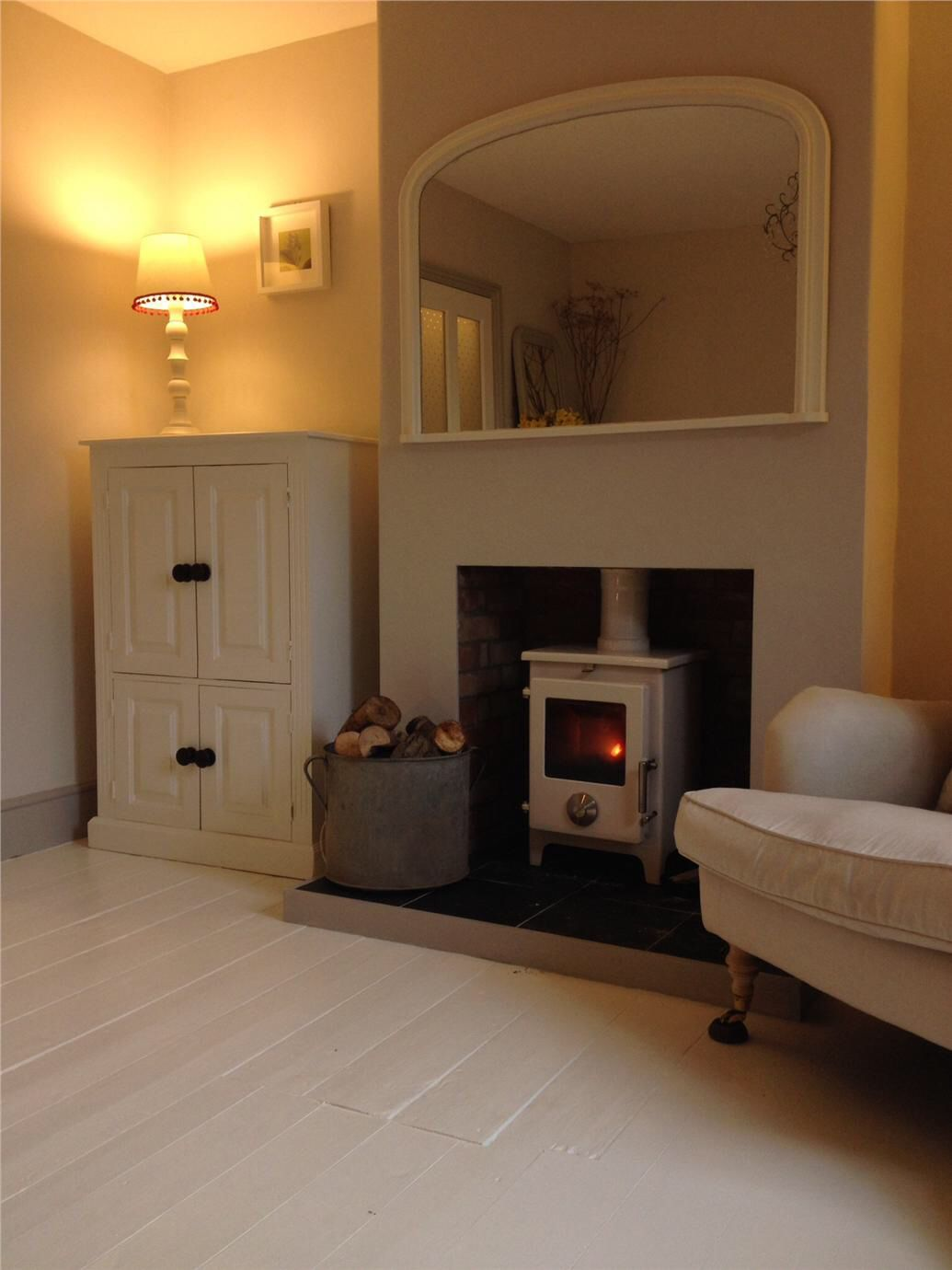 mirror on wall above wood burner  home living room house