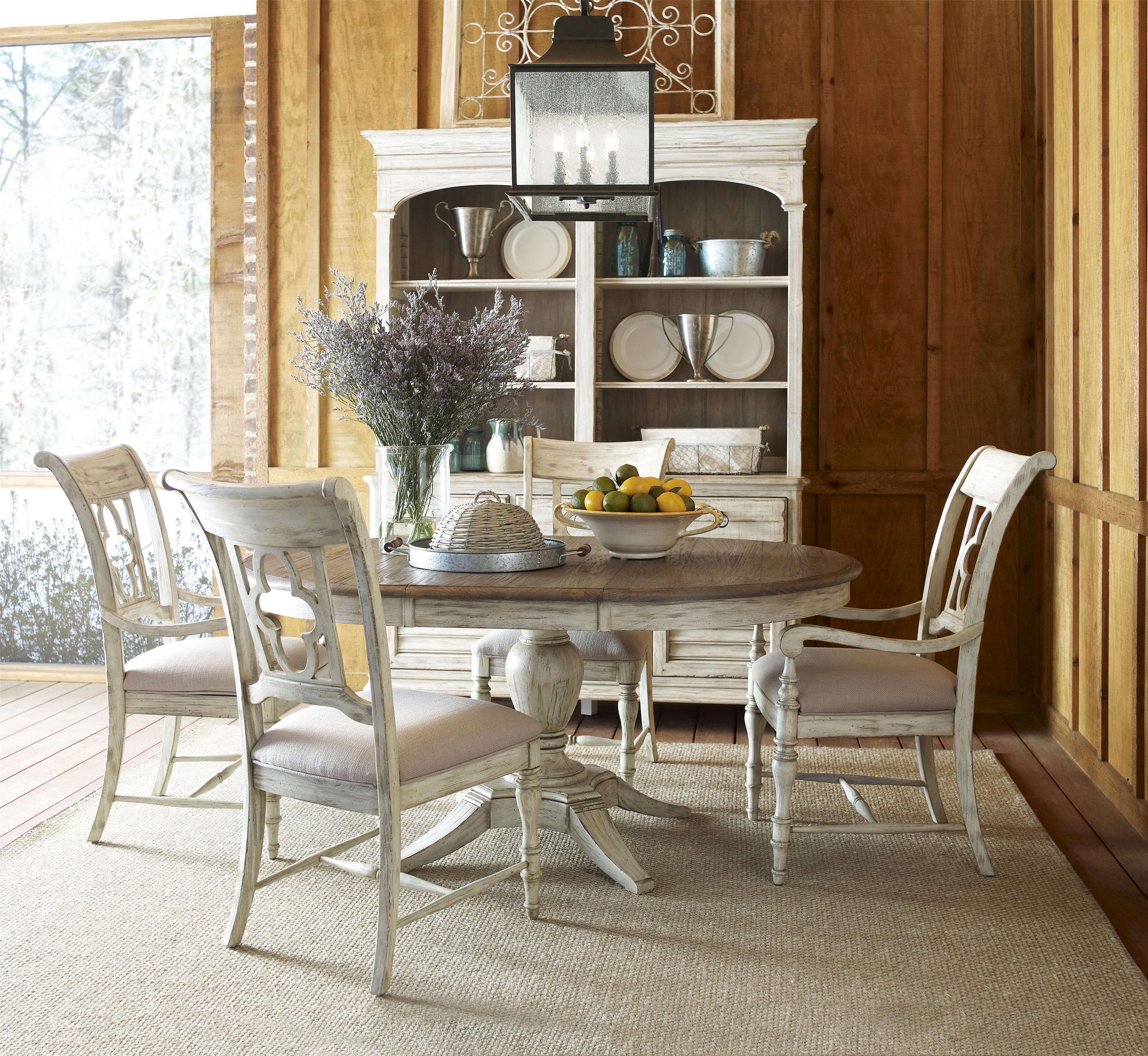 The Milford Dining Table Offers Quaint Cozy Charm With A Vase
