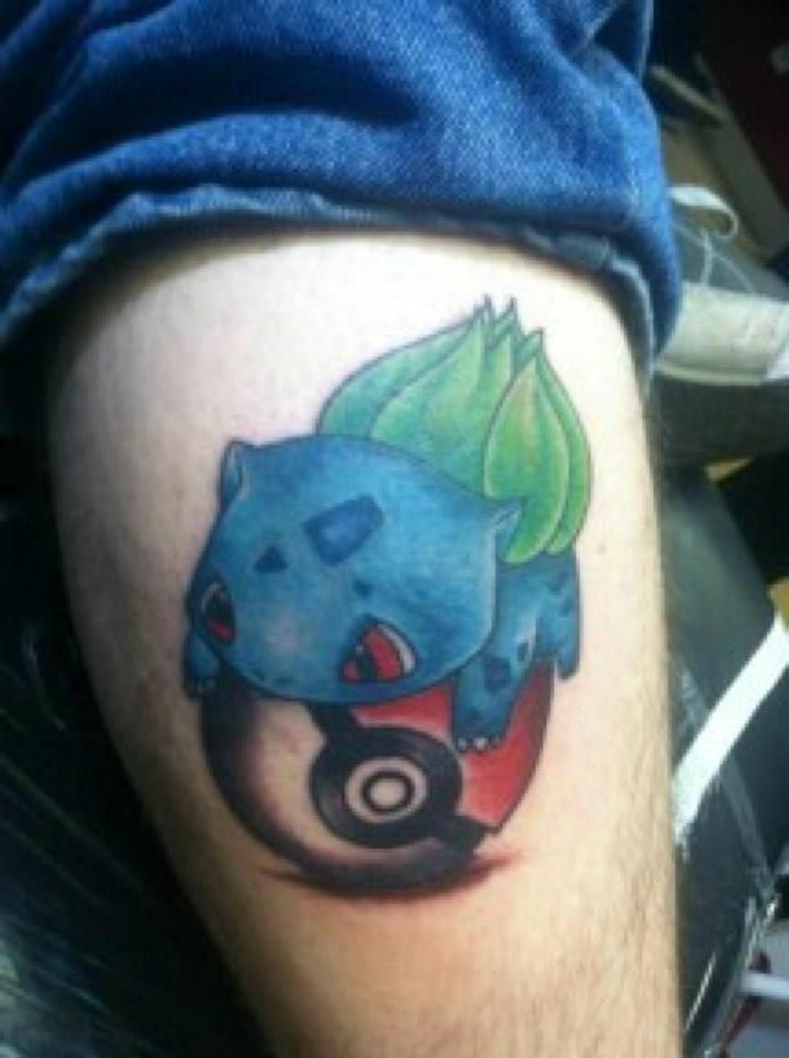 Bulbasaur and Pokeball Tattoo! Not the best tattoo but awesome idea.
